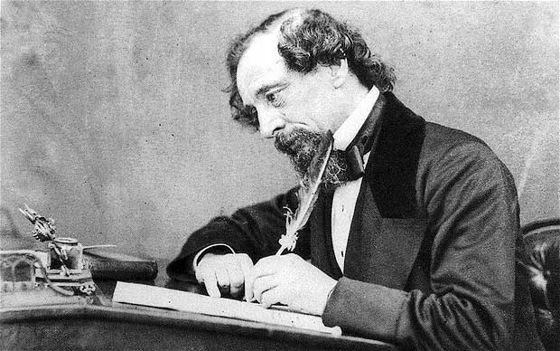 dickens-at-desk